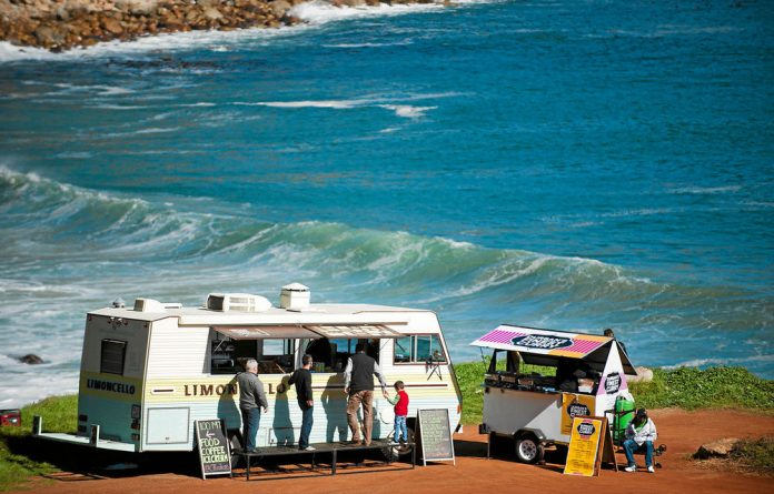 Customers can choose from the gourmet meals served from the food trucks.