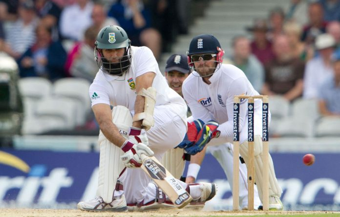 South Africa's Hashim Amla sweeps a ball from England's Graeme Swann during the third day of the first cricket Test match at The Oval in London.