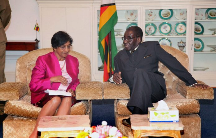 UN high commissioner for human rights Navi Pillay meets Zimbabwean President Robert Mugabe at State House in Harare.