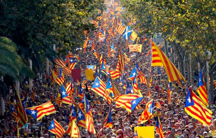 Show of support: Catalans march to mark Calatalonia Day in Barcelona last month. Separatists are determined to push for autonomy from Spain