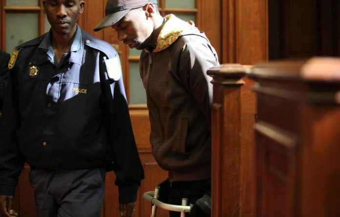 Murder-accused Xolile Mngeni walked into court with his walking frame.