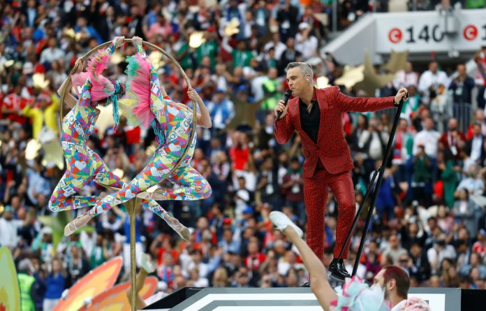 Robbie Williams performs during the opening ceremony.
