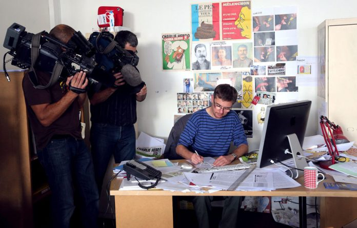 French satirical weekly Charlie Hebdo's publisher and cartoonist