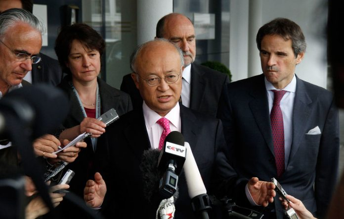 Director general of the International Atomic Energy Agency Yukiya Amano. Amano says he reached a deal with Iran on probing suspected work on nuclear weapons and adds that the agreement will