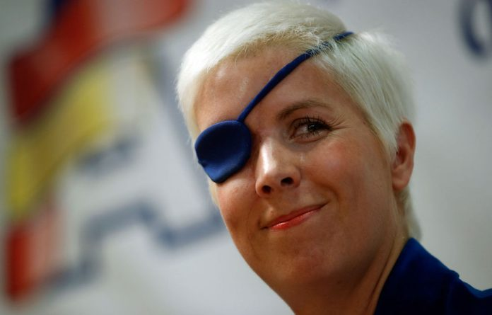 Marussia Formula One test driver Maria de Villota of Spain smiles during her news conference in Madrid on Thursday October 11