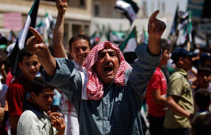 Syrian violence killed at least 12 people on Sunday