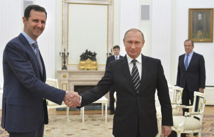 Vladimir Putin meets Bashar al-Assad in Moscow.