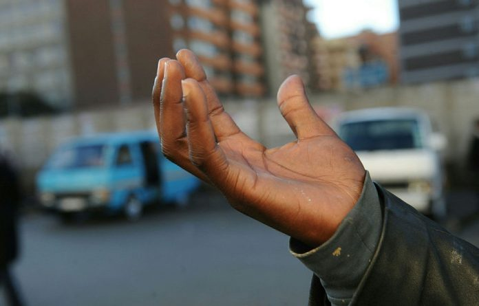 The taxi hand signal for Orange Farm township. The first ever