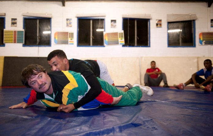 Frikkie Bosse demonstrates technical moves with the help of Marno Plaatjies at the Olympians gym in Durbanville. The Bosses have introduced wrestling to a number of communities.