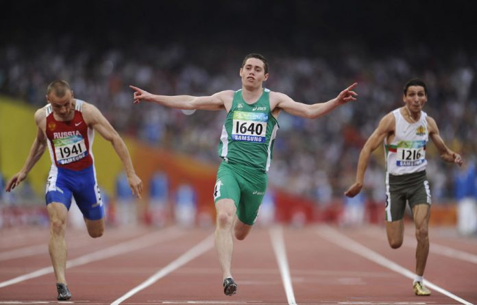 Jason Smyth of Ireland wins the gold in the men's 100m T13 final during the 2008 Beijing Paralympic Games