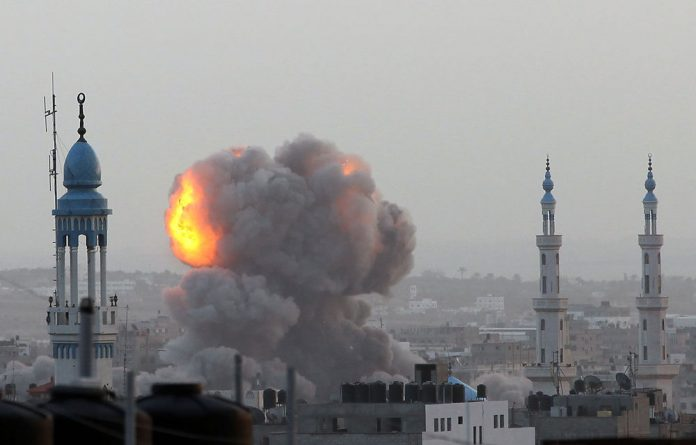 A fire ball rises as the Israeli air force carries out a raid over Gaza City
