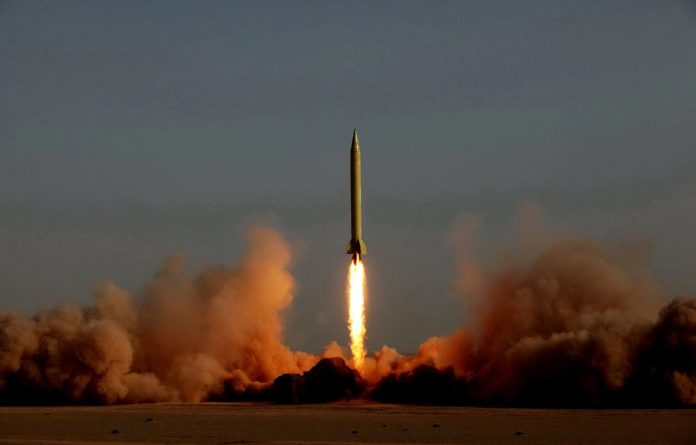 Iran has test-fired a ballistic missile capable of striking Israel as part of war games designed to show its ability to retaliate if attacked.