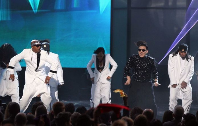 Psy performing with MC Hammer at the American Music Awards.