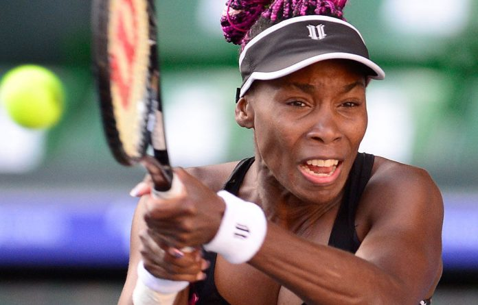 Venus Williams seen playing against Petra Kvitova at the Pan Pacific Open tennis tournament in Tokyo on September 27.