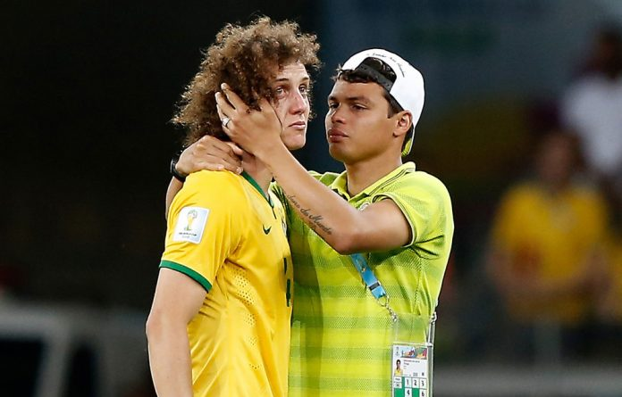 Brazil's Thiago Silva comforts defender David Luiz after the semifinal match between Brazil and Germany at The Mineirao Stadium in Belo Horizonte.