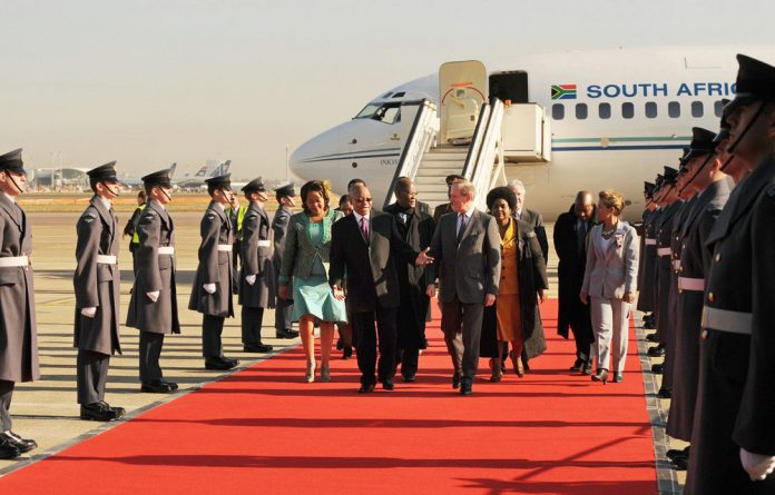 President Jacob Zuma and wife Thobeka Madiba-Zuma arrive at ­London's Heathrow Airport in the Boeing 737.