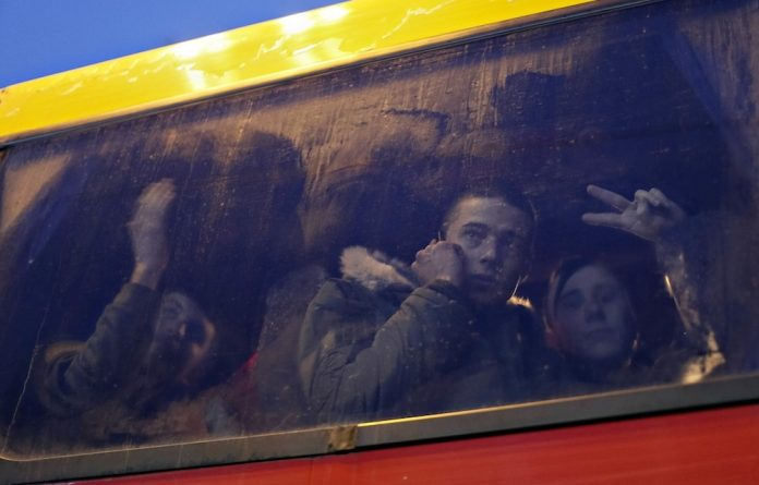 Faces of war: Ukrainian soldiers depart for the front line in the east of the country