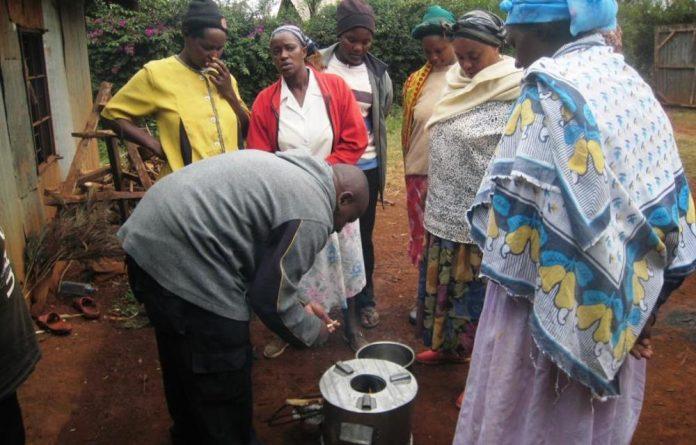 Keneth Ndua demonstrates his stove invention