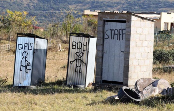 Makeshift toilets at a creche in Mathanga village in the Eastern Cape.