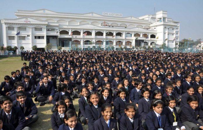 Schoolchildren gather in front of the City Montessori School in Lucknow