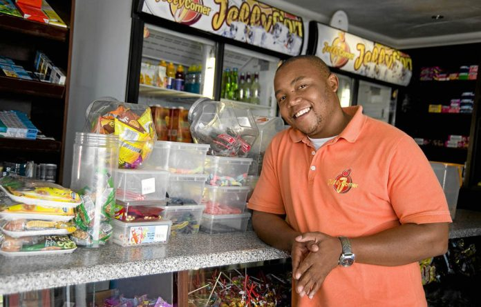 Kagiso Montoeli sells sweets and snacks from Jelly Corner