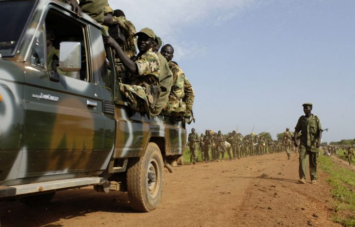 A handout picture released by the United Nations Mission in Sudan  shows Sudan People's Liberation Army troops redeploying south from Abyei.