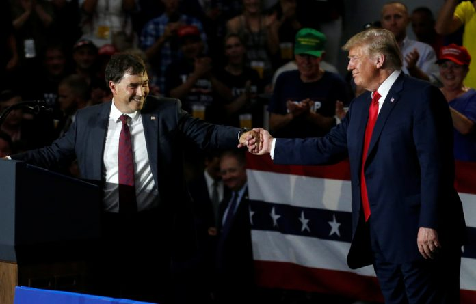 Ohio Senator Troy Balderson shakes hands with US President Donald Trump during a Make America Great Again rally in Olentangy Orange High School in Lewis Centre.