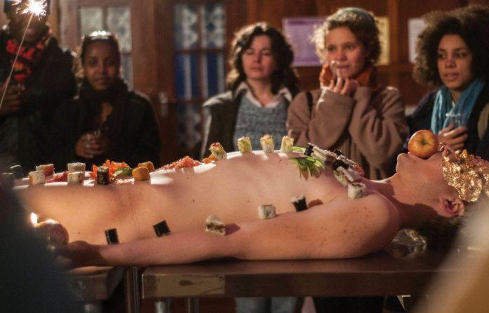 Gavin Krastin's near-naked body becomes a living buffet table in Omnomnom