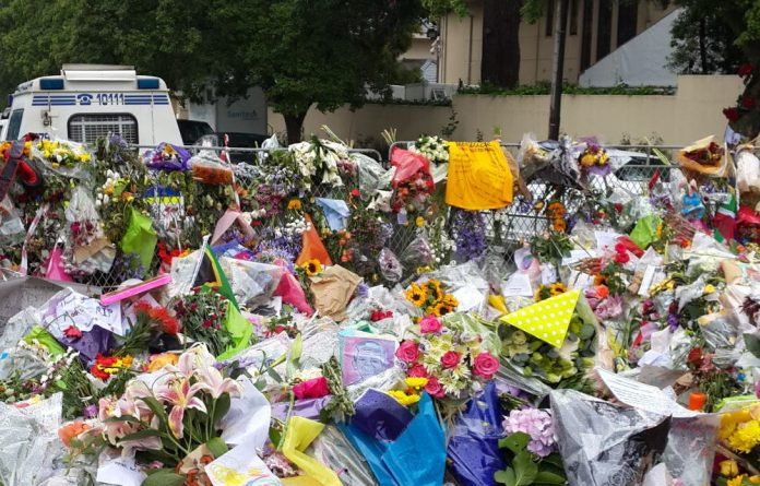 Flowers and tributes outside Nelson Mandela's Houghton house on the morning of his memorial service.