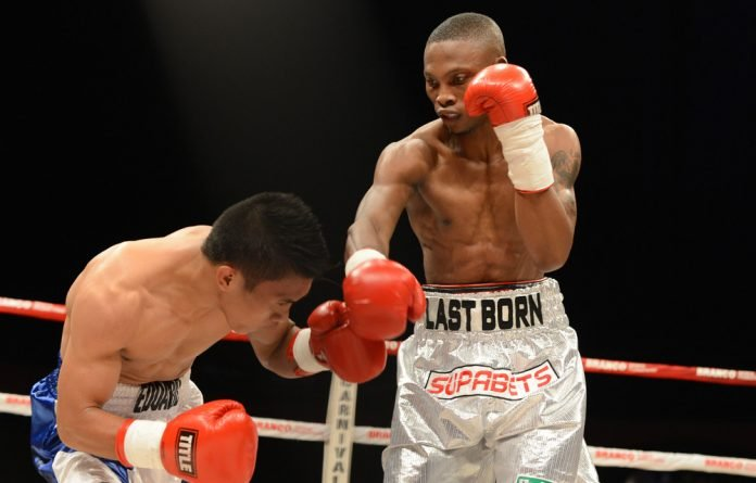 Zolani Tete and Eduard Peneria during the flyweight bout at Carnival City on March 23 2013.