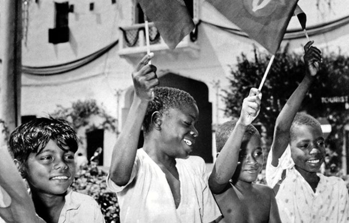 Children celebrate the independence of Zanzibar from Britain in 1963. Soon afterwards