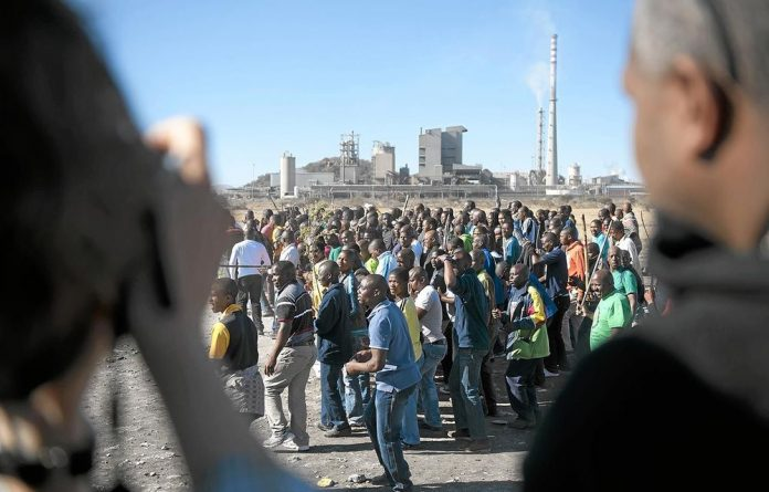 Striking miners gather at Lonmin mine.