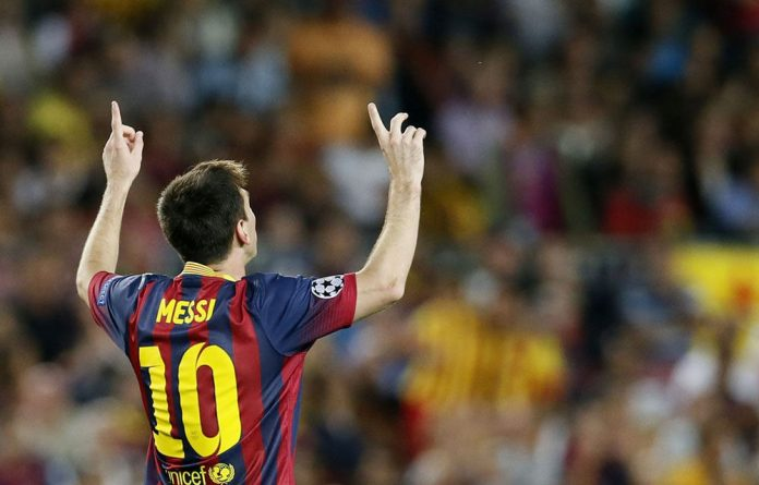 Barcelona's Lionel Messi celebrates his second goal against Ajax at the Camp Nou stadium in Barcelona.
