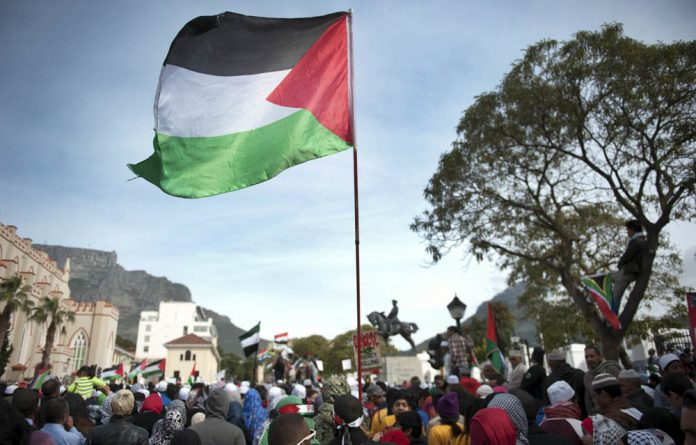Demonstrators held aloft scores of banners and posters calling for an end to the violence in Palestine's Gaza Strip.