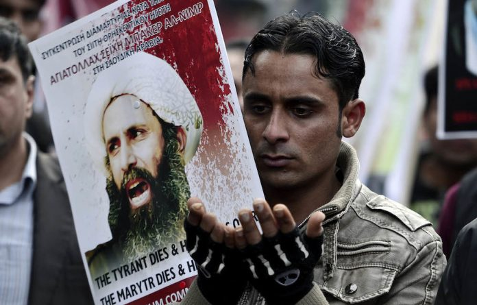 Violent reaction: The execution of the prominent Shia cleric and activist Nimr al-Nimr in Saudi Arabia has been overshadowed by the burning of the Saudi Arabian embassy in Tehran.