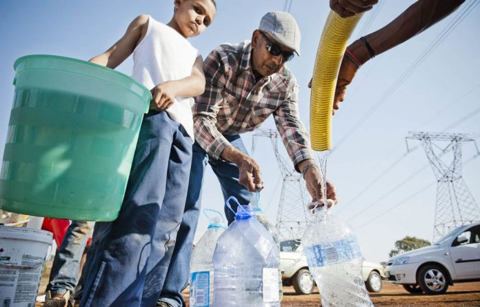 Gauteng residents that had no water collected the precious fluid from a tanker last September.