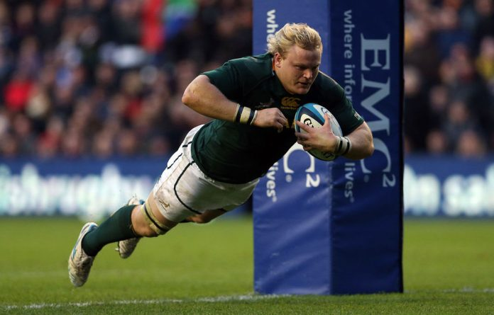 South Africa's hooker Adriaan Strauss scores his second try during the International rugby union test match between Scotland and South Africa at Murrayfield in Edinburgh.