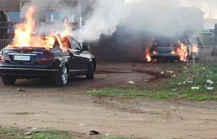 Police are holding five people in custody after cars were set alight with petrol bombs in Kuruman.