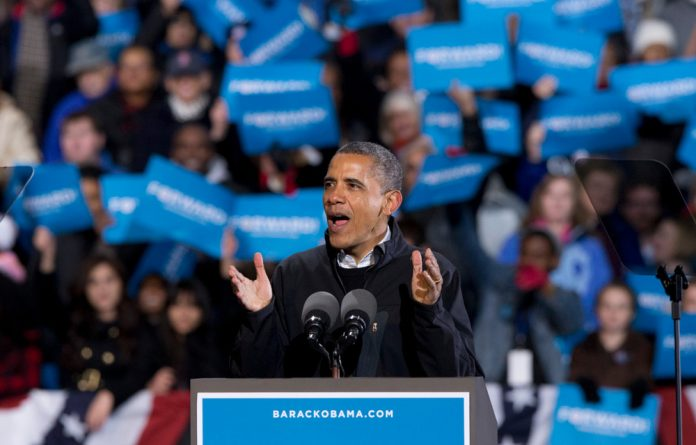 President Barack Obama speaks at a rally at the Jiffy Lube Live arena on November 3 in Bristow