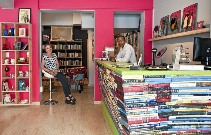 In the pink: Staff members Jennifer Tannahill and Tshepo Moselane at the quirky hospice shop in Braamfontein.