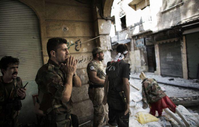 A Free Syria Army fighter yells 'Allahu Akbar'