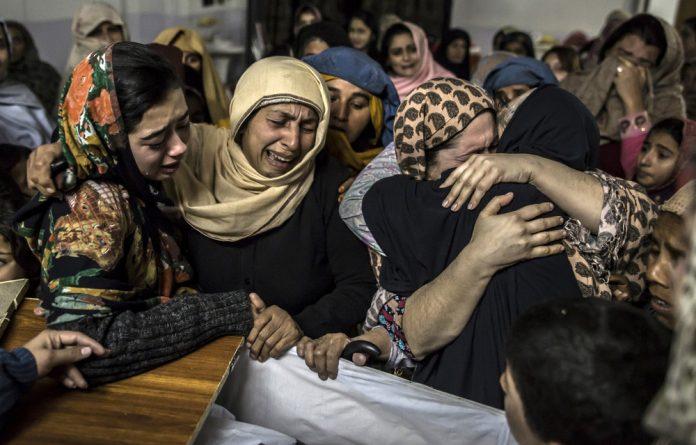 Parents mourn their children as burials get underway in Pakistan