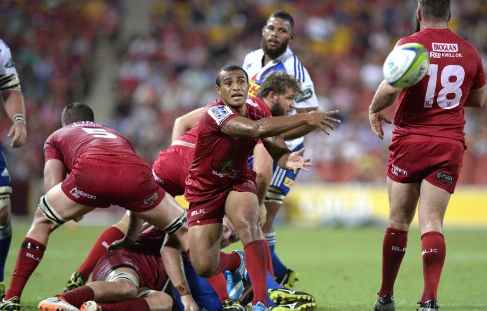 Will Genia of the Reds passes the ball during the Super Rugby match between the Reds and the Stormers.