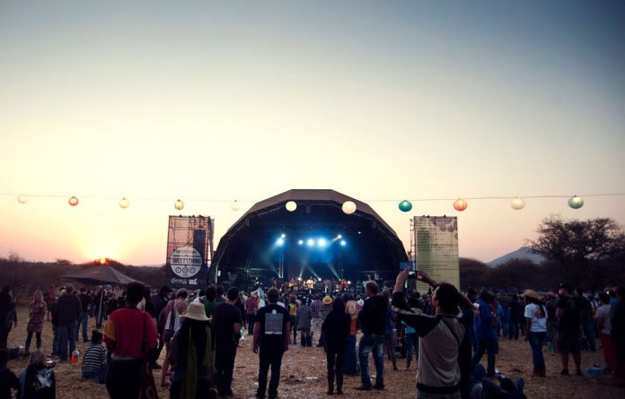 Oppikoppi revelers enjoy the Vusi Mahlasela tribute.