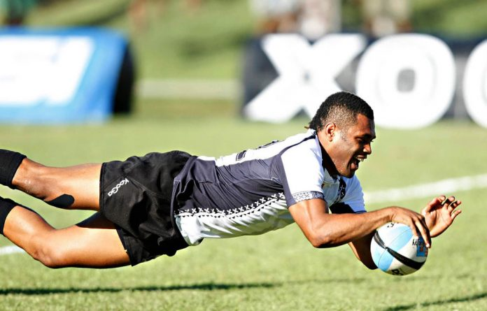 Metuisela Talebula bagged two tries as Fiji turned around a half-time deficit to beat Tonga.