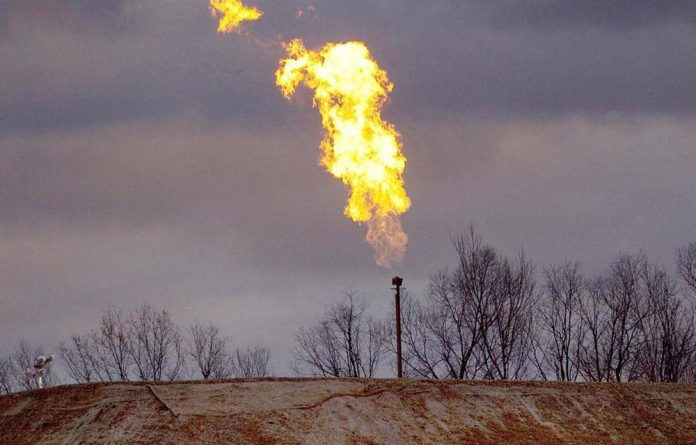 A gas flare burns at a fracking site in rural Bradford County