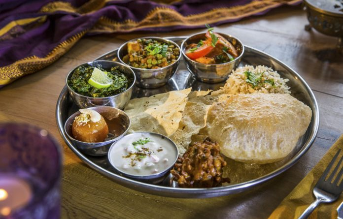 Why change a winning recipe? There is no set recipe for a traditional thali but they are delicious and provide a filling meal that can be shared with friends and family. Photos: Russ Rohde/AFP