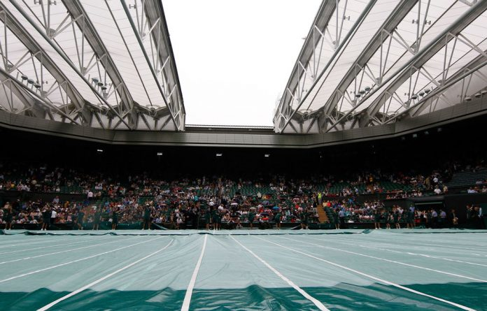 London's rainy conditions has provoked more debate over the Centre Court's roof.
