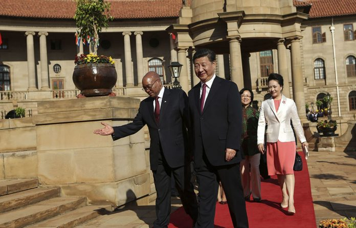 President Jacob Zuma and President Xi Jinping of China arrive at the Union Buildings for bilateral talks on trade links.