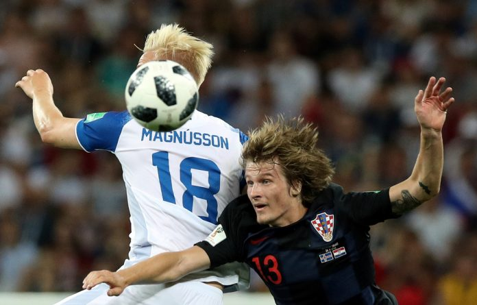 Croatia's Tin Jedvaj in action with Iceland's Hordur Magnusson